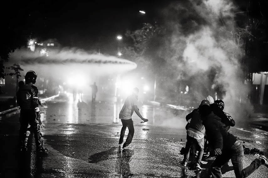 Protesters fighting against police water cannons at night, Ankara, 11/06/2013