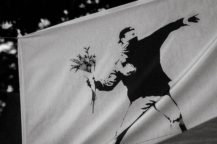 A banner with the Banksy Flower Thrower, Istanbul
