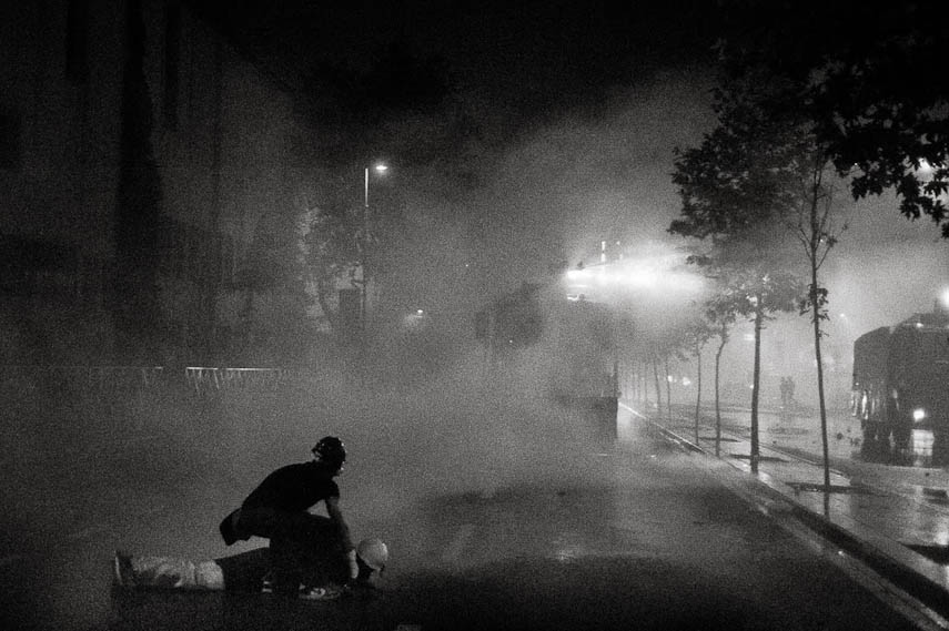 A riot police officer shield himself from firecrackers. Istanbul 16/06/2013