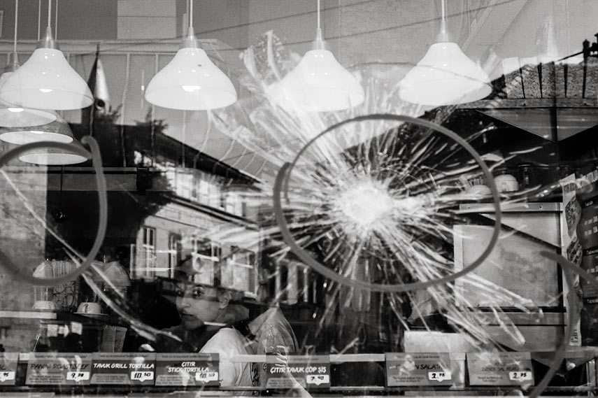 Broken windows in an Istanbul cafe,  04/06/2013