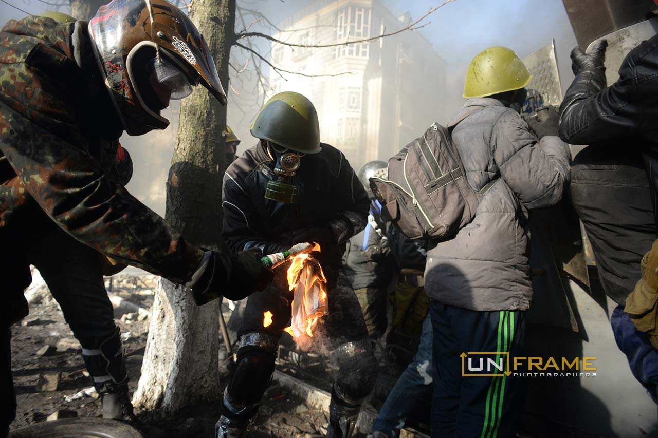 Protesters ignite petrol bombs to be next hurled towards the riot police. Kiev, Ukraine