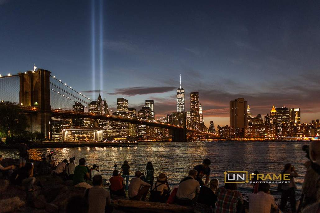 A crowd of some 100 people gathered at the Brooklyn Bridge Park in Dumbo to spectate and phptograph the Tribute in Light memorial on the 13th anniversary of 9/11. Sept. 11, 2014. New York, USA. Photo by Riccardo Budini / UnFrame