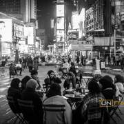 Muslim women in their typical clothing share their meal in Time Square.  New York, USA. Sept. 13, 2014 Photo: Riccardo Budini /UnFrame. New York, USA. Sept. 13, 2014