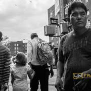 """Parents pick up their sons up from school. Middle class families are breaking in the intensely diversified social pattern of Jackson Heights in a sort of """"counter white flight"""". Queens, New York City."""