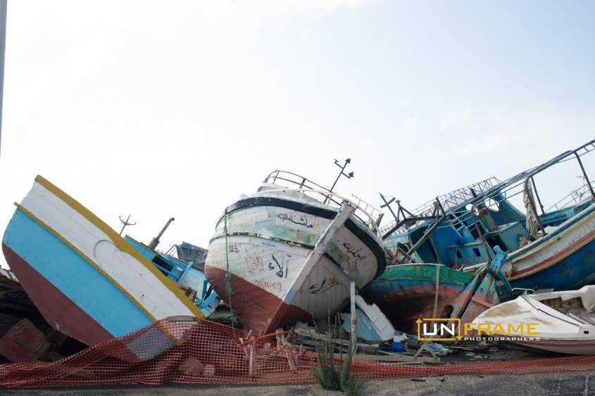 Wreckages of fishing boats used by human traffickers to transfer migrants from Africa to Europe are piled up in an area of the Sicilian port of Pozzallo.